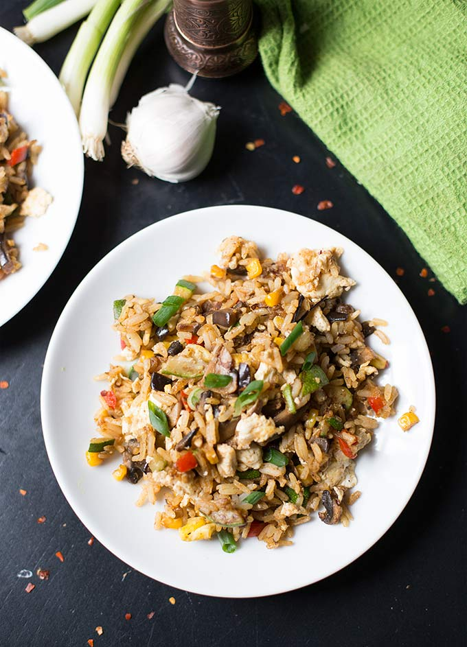 This recipe for Veggie Fried Rice is packed full of nutritious veggies and Asian flavor. Perfect for a quick and easy dinner to use up extra vegetables!
