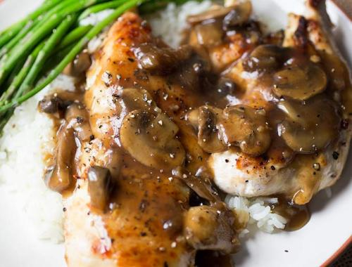 This Chicken Madeira recipe is easy to make but tastes gourmet! Lightly browned chicken smothered in a rich Madeira sauce and served over rice.