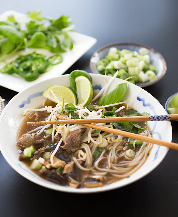 Easy Vietnamese Pho - homemade broth, thinly-sliced beef, fresh veggies and rich flavors come together in this easy but delicious Vietnamese Pho recipe!