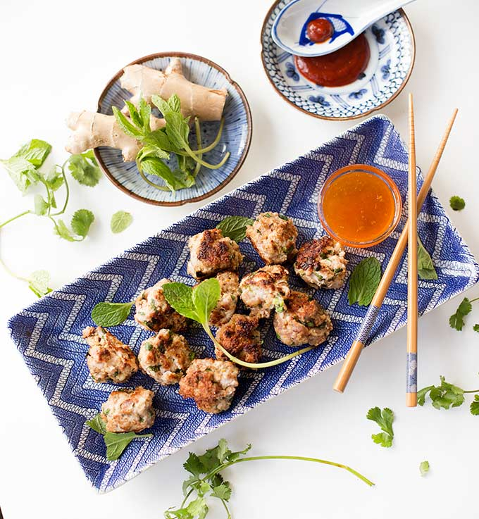 Spicy Thai Meatballs with Apricot Dipping Sauce: Little pork or lamb appetizers with an Asian twist and a sweet-tart sauce for dipping!