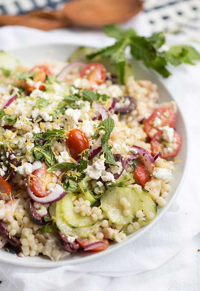 Mediterranean Couscous Salad: tomatoes, cucumbers, olives, feta and mint tossed with Israeli Couscous in a lemony vinaigrette. Salad perfection!
