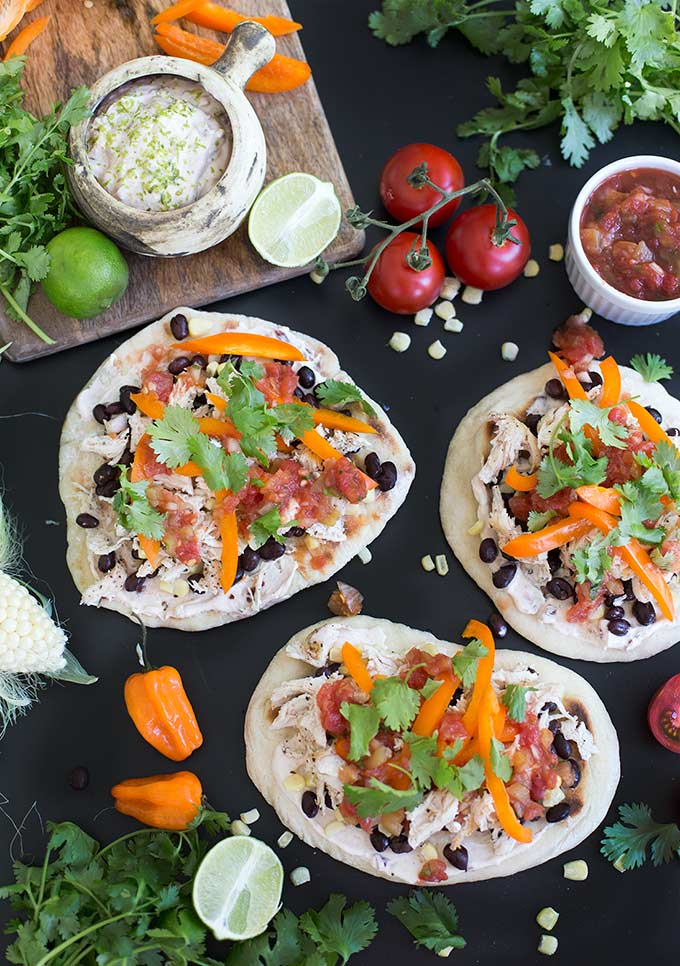 Southwestern Flatbread combines peppery chicken with sweet peppers, black beans and corn on a homemade flatbread for a southwest twist on a classic.