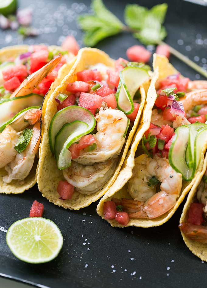 Shrimp Tacos with Watermelon Salsa - a unique combination of garlic-lime shrimp tacos, topped with watermelon salsa and marinated cucumbers. Fresh and fun!