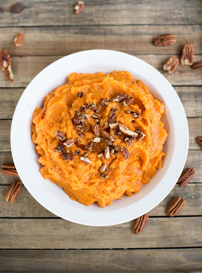 Maple-Pecan Mashed Sweet Potatoes - sweet potatoes, coconut milk and maple syrup whipped to creamy perfection and topped with spiced pecans.