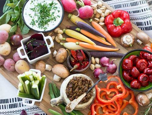 Crudité Platter: Fresh veggies and two quick and easy dips, Buttermilk Herb and Sun-dried Tomato Pesto, make a beautiful, delicious party appetizer.