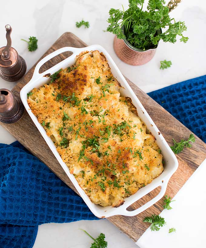 Baked Macaroni & Cheese - cheesy and creamy baked macaroni topped with toasted breadcrumbs and fresh herbs. Comfort food at its finest!