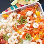 One-Pan Shrimp Fajitas - garlic lime shrimp, onions and peppers combined with spices for a simple, quick weeknight dinner.
