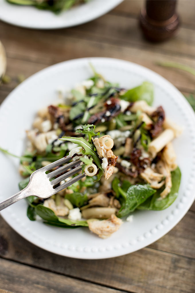 Balsamic Chicken and Brown Rice Pasta Salad - gluten-free brown rice pasta tossed in a balsamic vinaigrette and mixed with greens, blue cheese, sun-dried tomatoes and shredded chicken. A simple, delicious and filling salad!