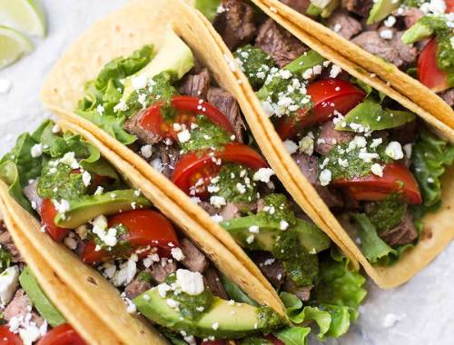 Steak Tacos with Cilantro Chimichurri Sauce - tender, flavorful meat grilled to perfection wrapped in a corn tortilla and drizzled with a fresh cilantro chimichurri sauce.