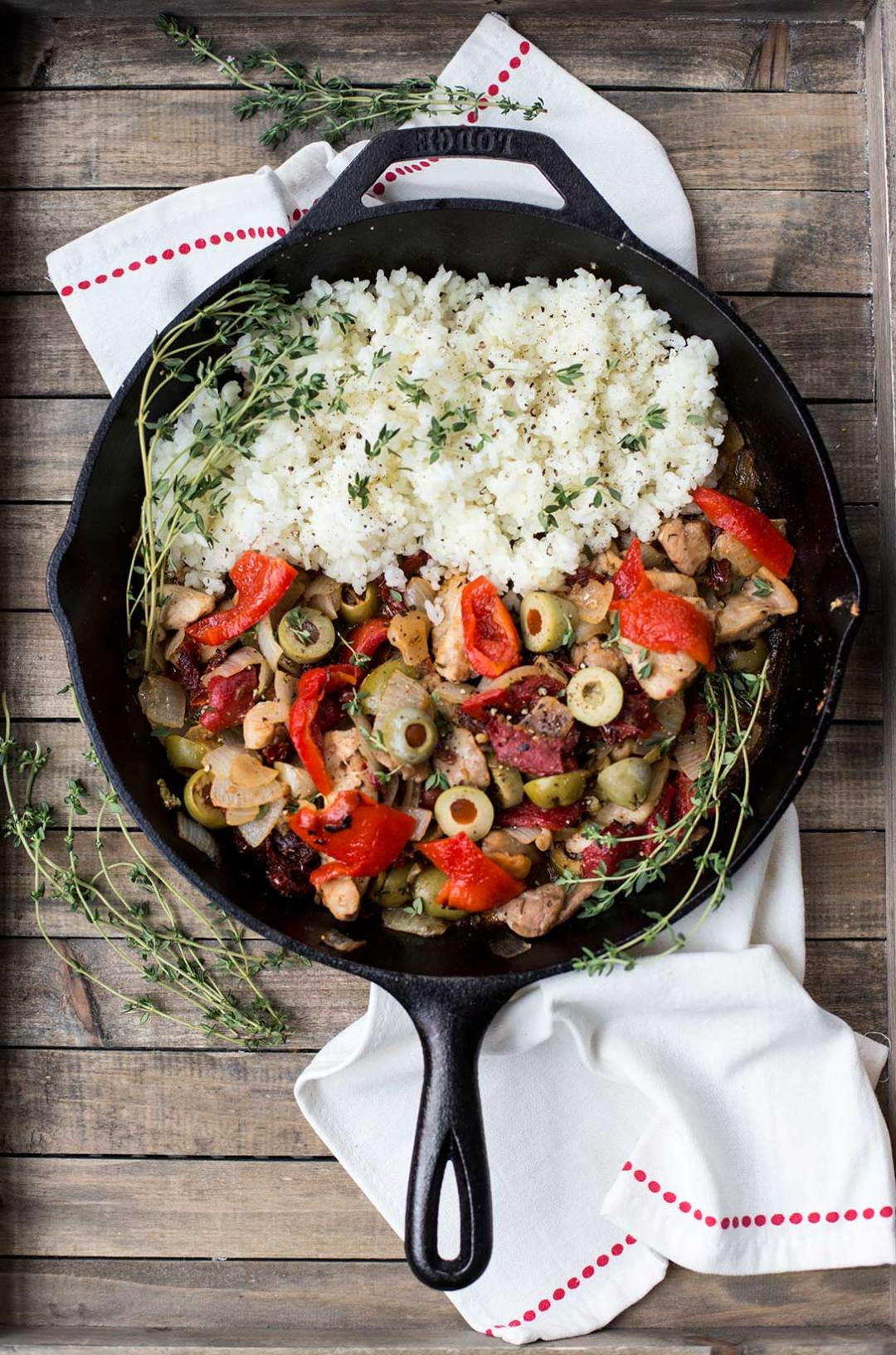 Portuguese Chicken and Rice: Chicken pieces sautéed with onions, mushrooms, peppers and sun-dried tomatoes make the perfect dinner in a pan! Add some green olives and lemon zest for authentic Portuguese flavor.