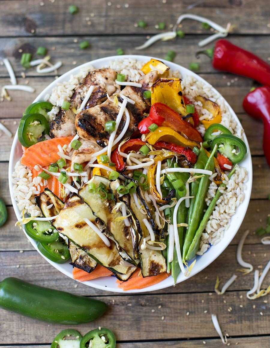 Asian Chicken Veggie Bowl - marinated chicken and grilled veggies are piled high on a bed of brown rice and drizzled with a soy ginger dressing. A simple, healthy meal.