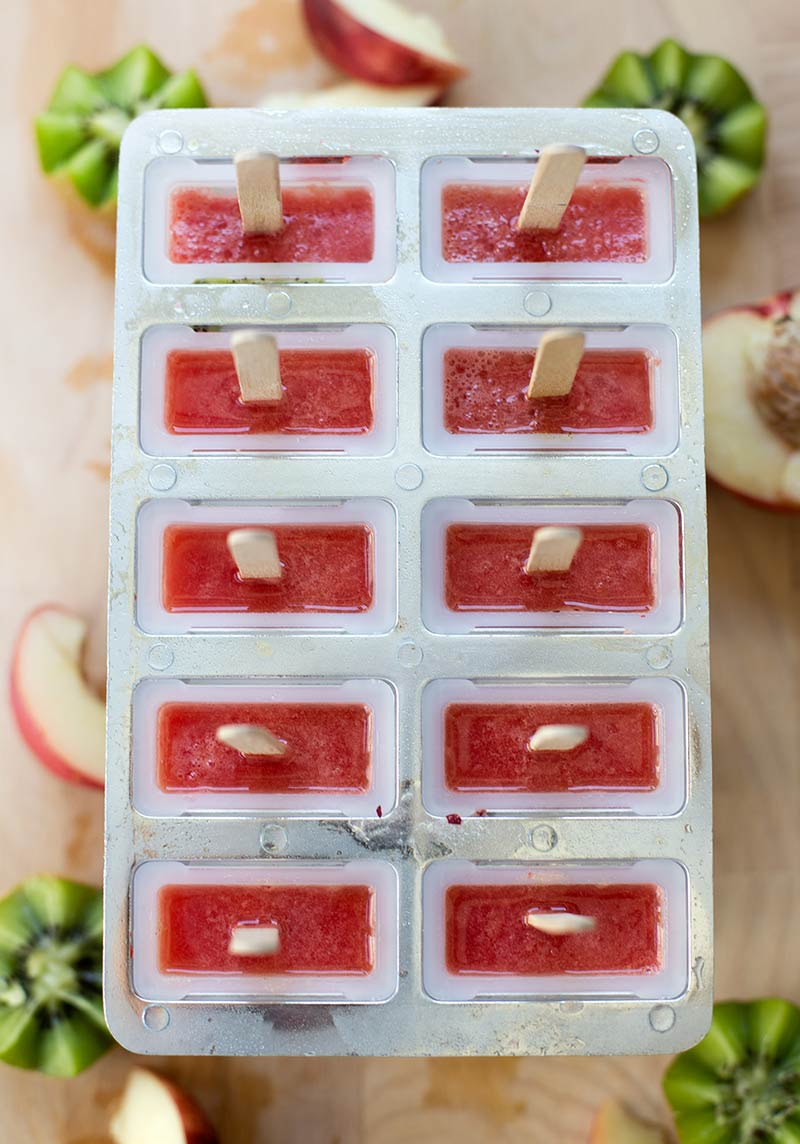 100% Fruit Popsicles: Just frozen fruit on a stick! Nectarines, watermelon and kiwi pureed and frozen for a clean refreshing treat!