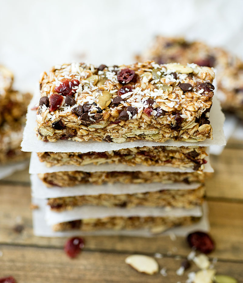 Trail Mix Granola Bars - homemade bars made from oats, dried fruit, nuts and chocolate and sweetened with honey! A healthy alternative to store-bought bars.