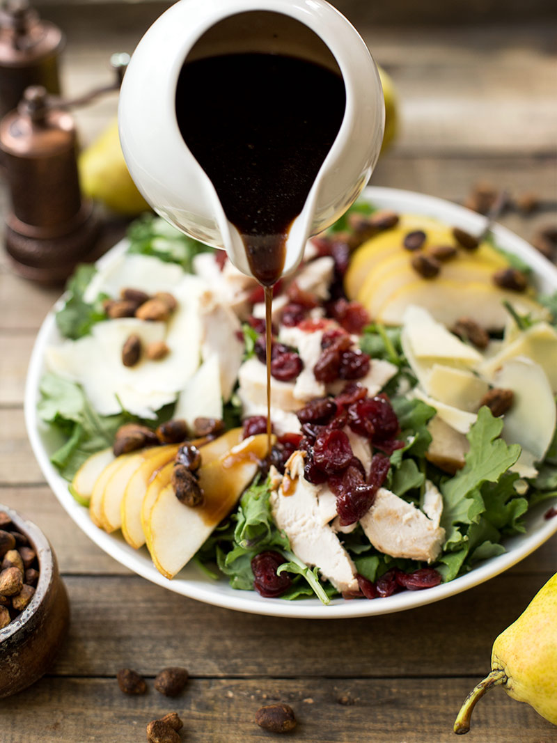 Chicken, Pear and Cheddar Salad with Maple Dressing - a bed of baby kale topped with pears, dried cranberries, cheddar cheese and spiced pistachios.