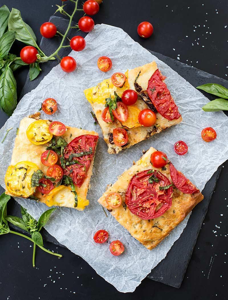 Triple Tomato Focaccia Bread - soft, fluffy foccacia bread full of sun-dried, cherry and garden tomatoes. A simple way to make delicious homemade bread!