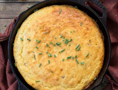Bacon and Cheddar Skillet Cornbread: Savory, slightly sweet cornbread baked in a cast iron skillet, elevated with bacon and sharp cheddar baked inside.