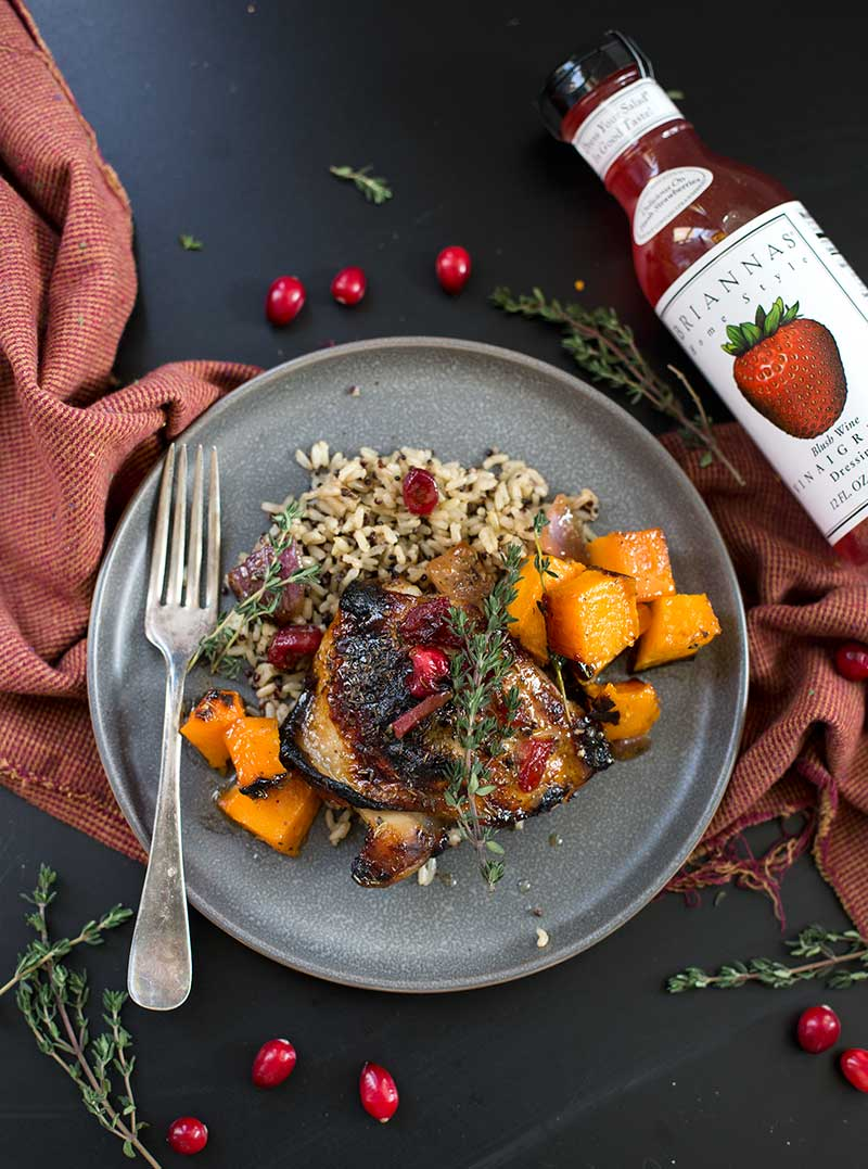 One-Pan Cranberry Herb Chicken - chicken thighs marinated in BRIANNAS Blush Wine Vinaigrette, fresh herbs and cranberries on one pan for an easy meal!