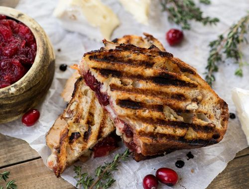 Turkey Cranberry Paninis: The perfect Thanksgiving leftover lunch! Melty cheese, turkey, cranberry, fresh thyme and a little balsamic glaze to top it off.