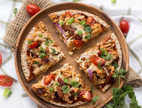 20-Minute BBQ Chicken Pita Pizza: A simple meal for families on the go! BBQ chicken, veggies and pepper jack tossed on pitas and baked in the oven.