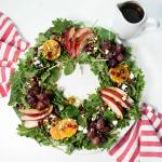 Christmas Salad Wreath - Your favorite greens arranged in a wreath and topped with oranges, pears, pomegranates and feta, to create a festive holiday salad!
