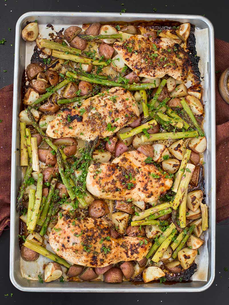 Sheet Pan Honey Mustard Chicken: Potatoes, chicken and asparagus tossed with a sweet and tangy sauce, baked and ready in just 30 minutes!
