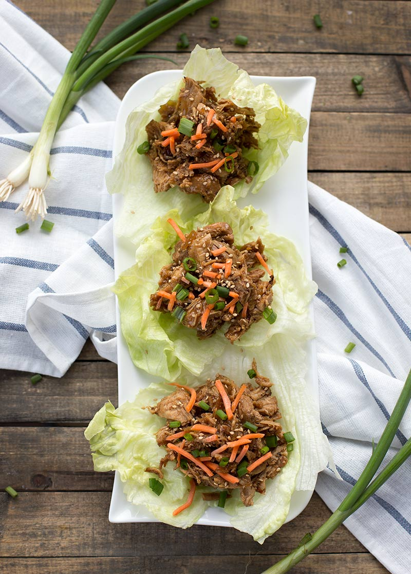 Freezer Meal Honey Sesame Chicken - sweet, sticky, shredded chicken that can be served in lettuce wraps, over a bowl or rice or on a slider bun!