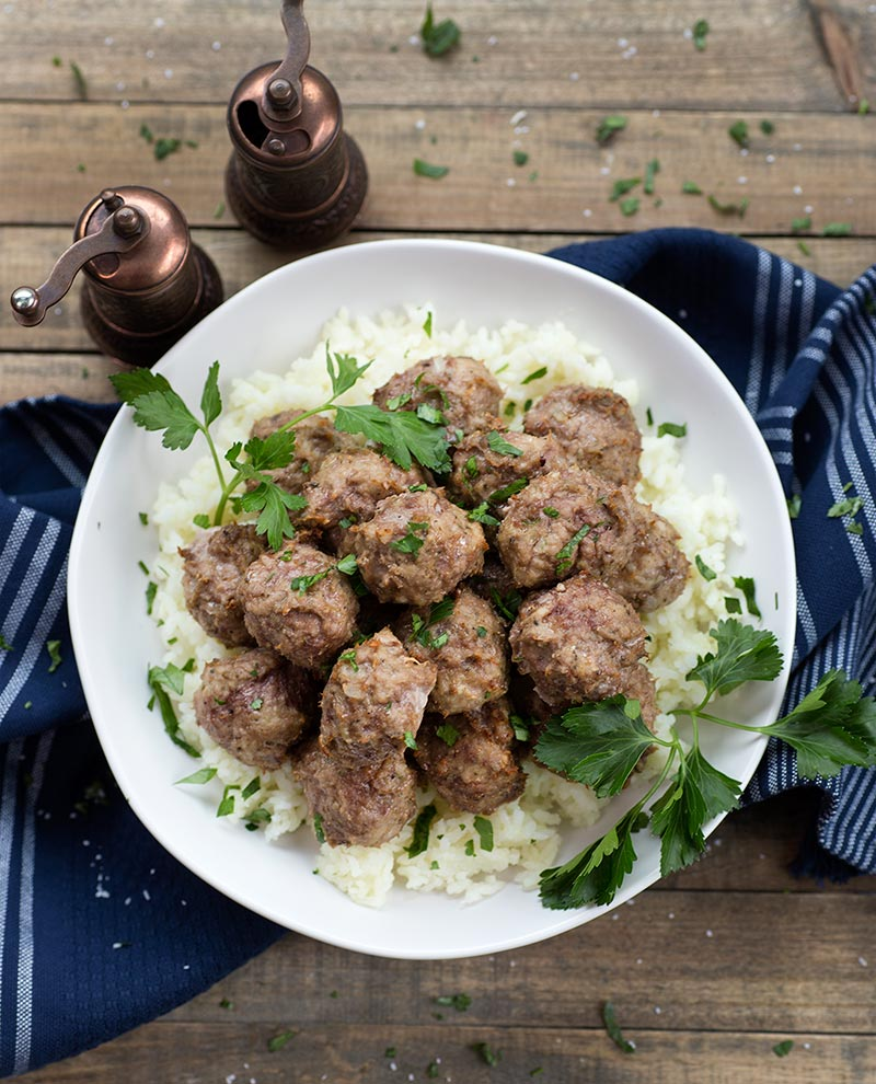 Go with anything Freezer Meatballs - a simple meatball made from ground turkey, beef and herbs. Can be frozen raw to cook when you need a last-minute meal!