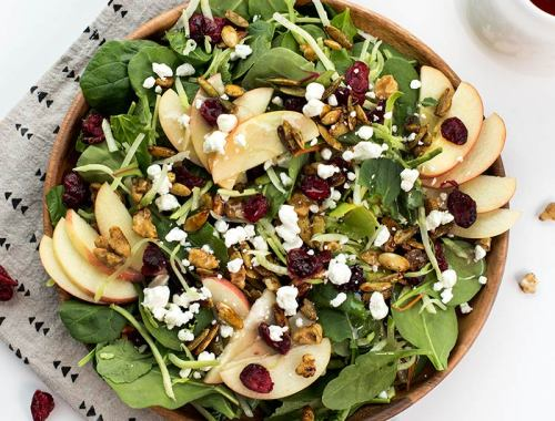 Sarah's Sunday Salad - spinach, kale and broccoli slaw, tossed with apples, craisins, crumbled goat cheese and maple-sugared nuts. A simple, tasty salad!