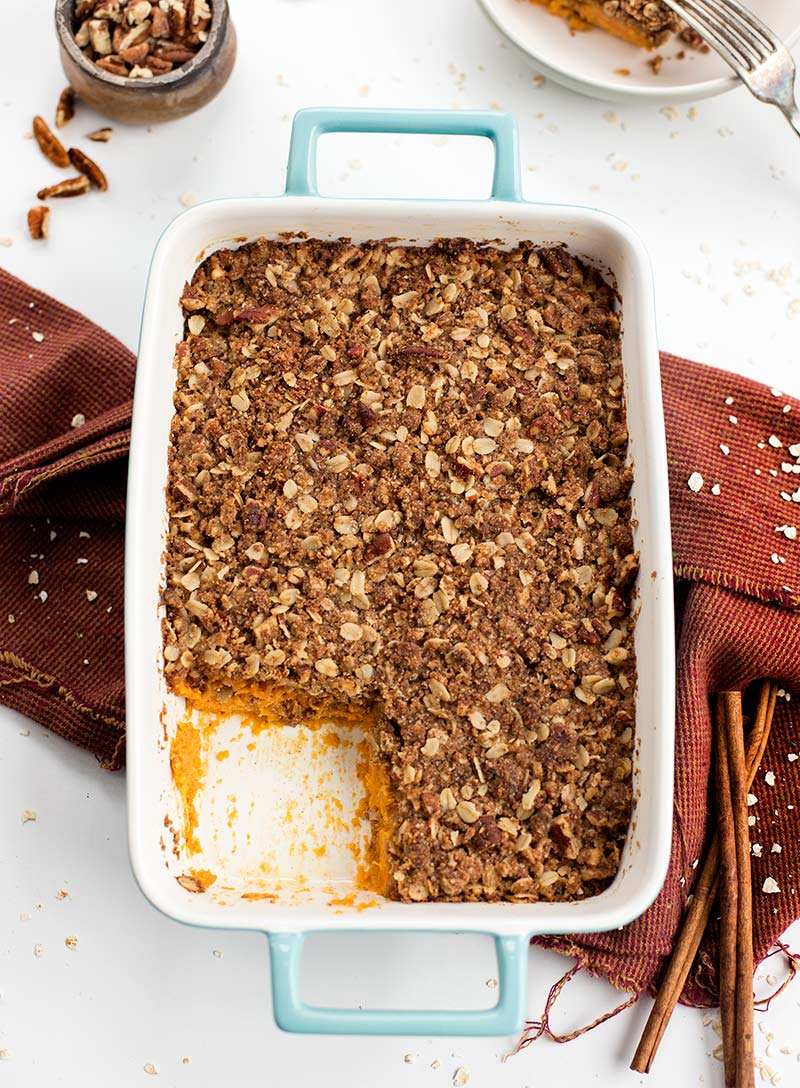 Sweet Potato Casserole - sweet potatoes mixed with coconut milk, maple syrup and spices are topped with a sweet, crumbly crust. Gluten and dairy free!