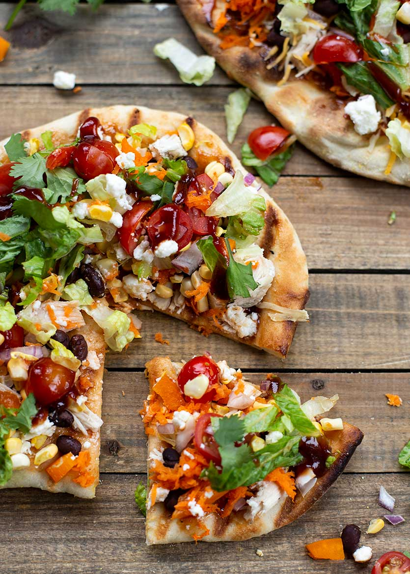 Grilled BBQ Chicken Salad Pizza: Grilled homemade dough, BBQ sauce, chicken and salad toppings like corn and avocado create the perfect light, summery meal!