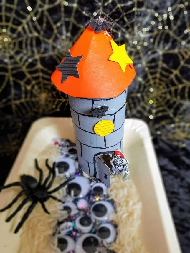 Make a toilet roll haunted tower scene top down