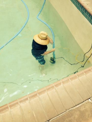 John setting pump to drain our pool for repairs and cleaning