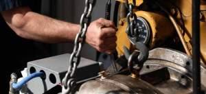 mechanic working on lifting clutch/transmission