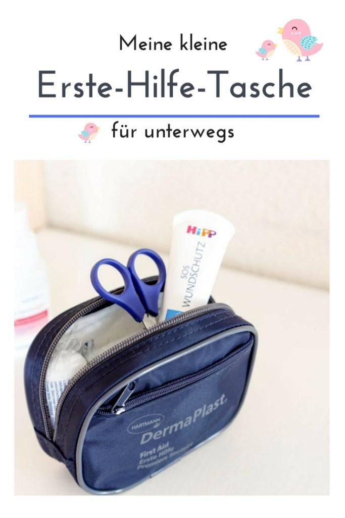 Wundschutzcreme und Schere in Erste-Hilfe-Tasche für unterwegs