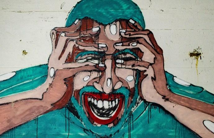 Graffiti mit Mann der Angst hat