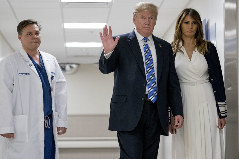 President and Mrs. Trump visiting victims of Florida shooting_1518833100730.jpeg.jpg