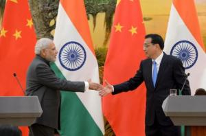 Indian Prime Minister Narendra Modi (L) shakes hands with Chinese Premier Li Keqiang during a news conference at the Great Hall of the People in Beijing, China, May 15, 2015. REUTERS/Kenzaburo Fukuhara/Pool