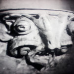 A gargoyle at the church--does not look like a grasshopper to me.