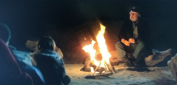 Telling ghost stories around the campfire