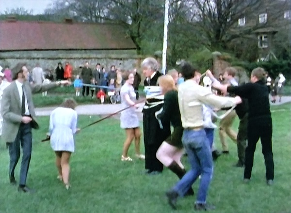 Doctor tied to a maypole