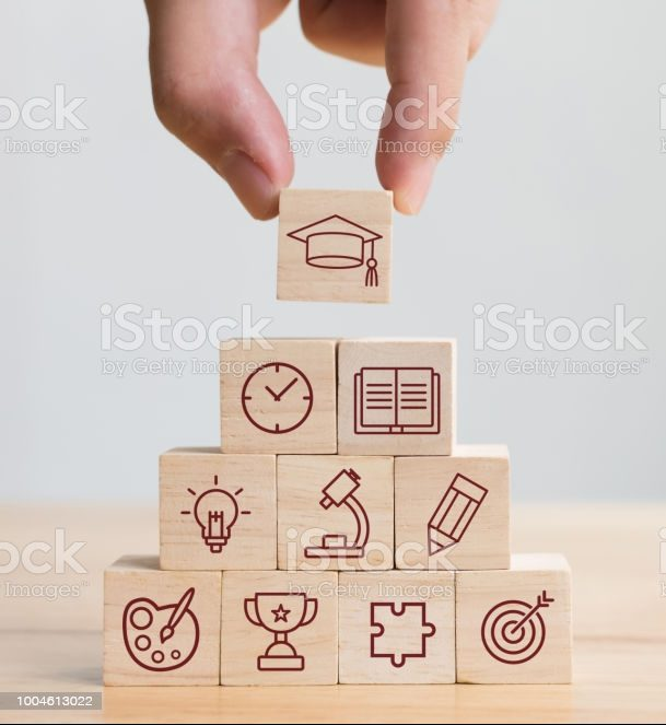 Hand arranging wood block stacking with elements education icon. Diagram of knowledge graduation concept