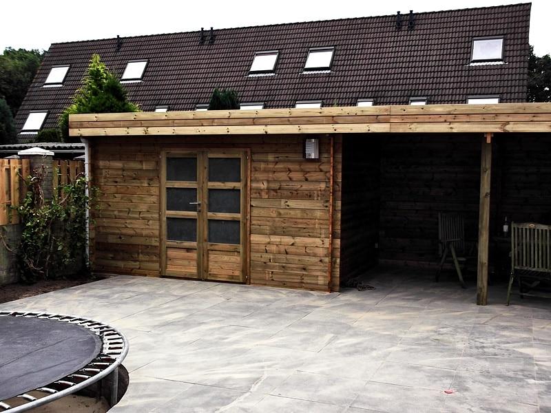 Verbouw tuin met tuinhuis zithoek en bestrating klussen for Tuin verbouwen