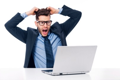 Frustrated Businessman Pulling Out His Hair