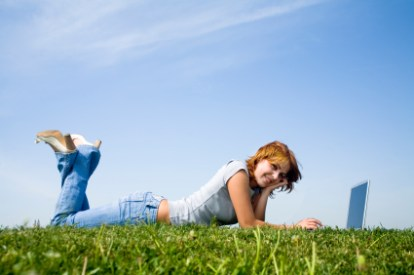 young girl with laptop on the grass (1)