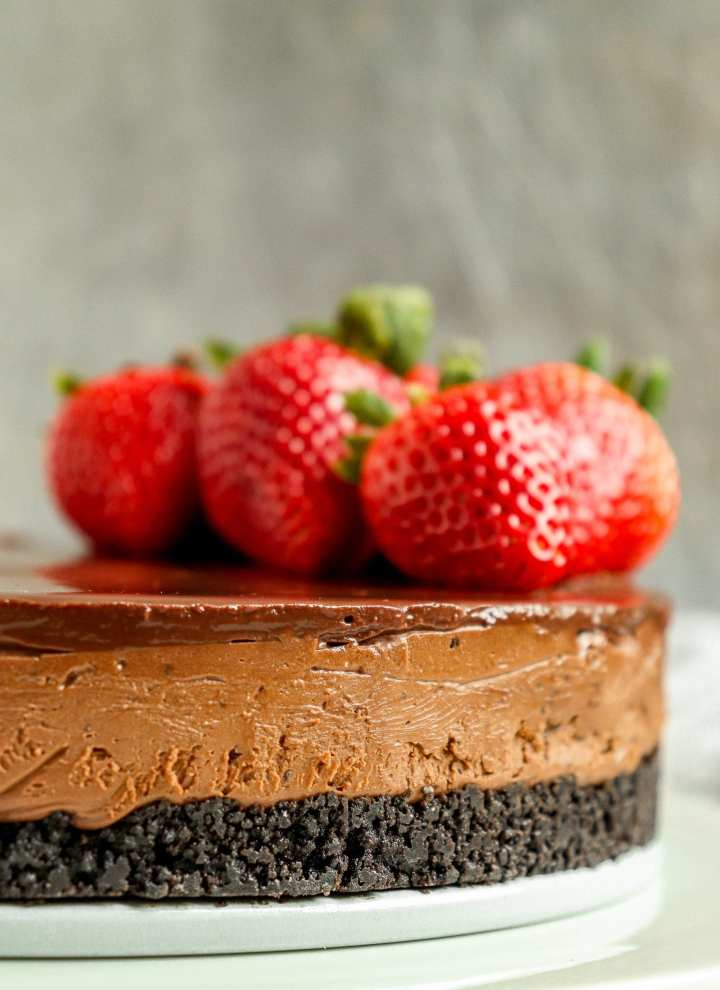 chocolate cheesecake with fresh strawberries on top