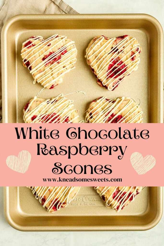 heart-shaped white chocolate raspberry scones on a gold baking pan