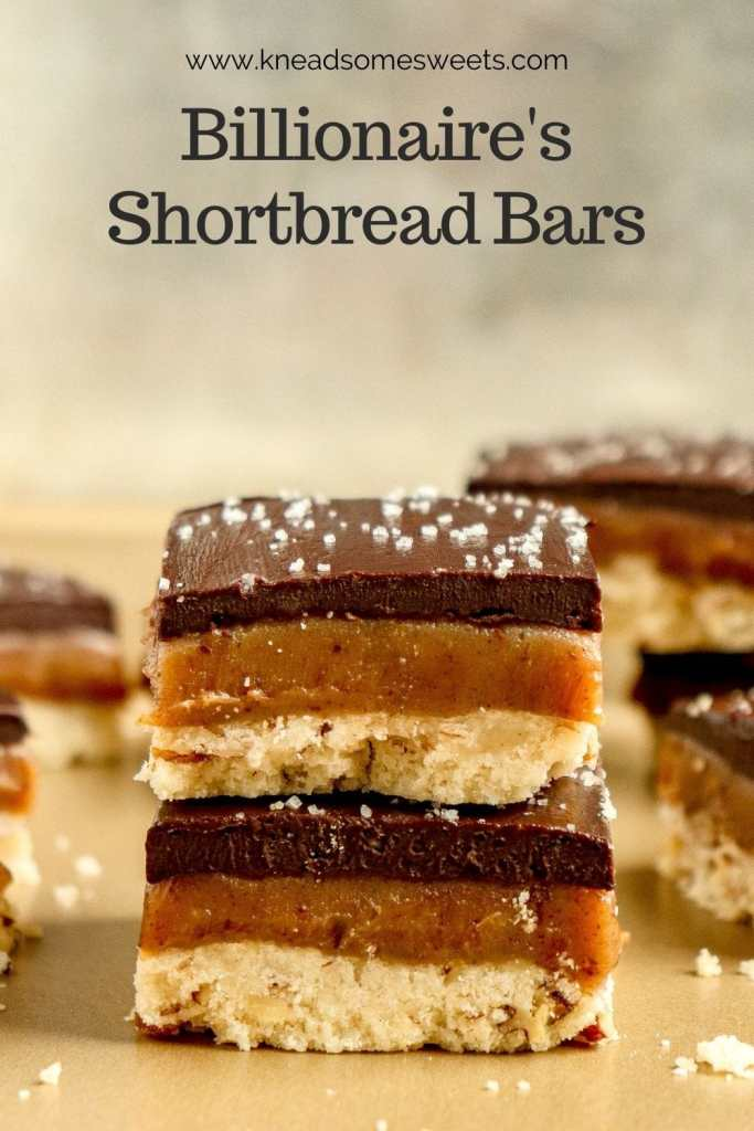 stack of pecan caramel shortbread bars topped with dark chocolate ganache