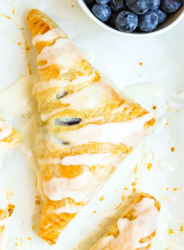 blueberry turnover topped with lemon icing