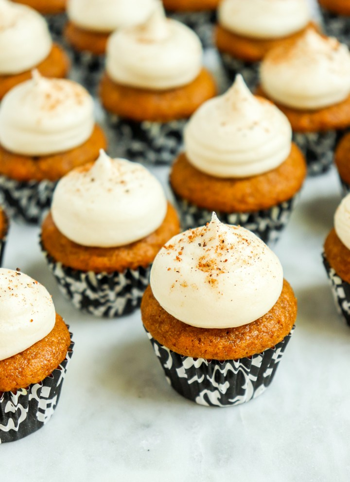 cupcakes topped with cream cheese frosting