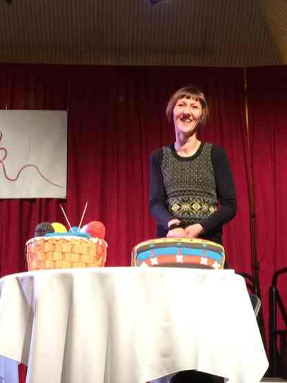 Patron Donna Smith cuts the cakes at the opening ceremony